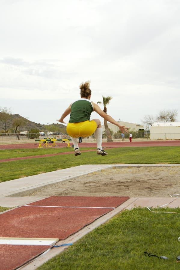 O Salto Longo Das Mulheres Fotografia De Stock Grátis