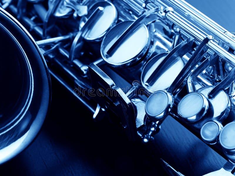 O saxofone macro da imagem foto de stock
