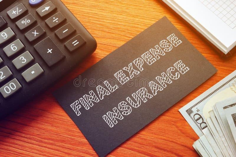 O seguro final de despesas é mostrado na foto comercial em questão imagem de stock