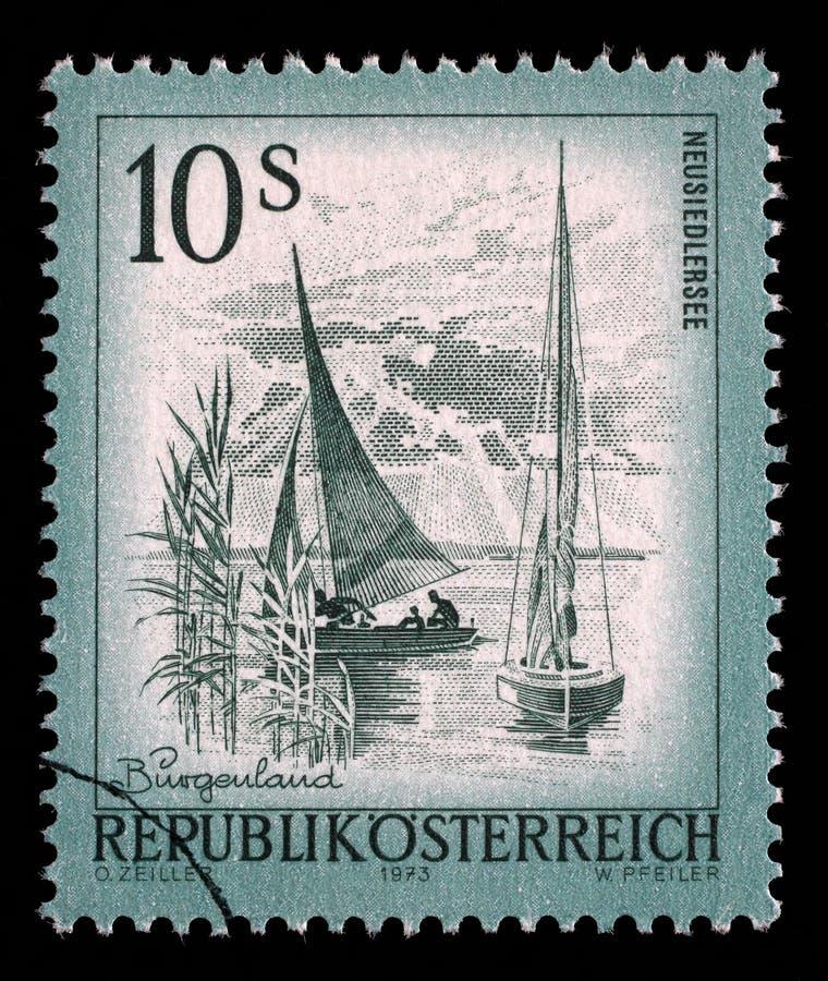 O selo impresso em Áustria das vistas emite o lago Neusiedlersee das mostras imagem de stock