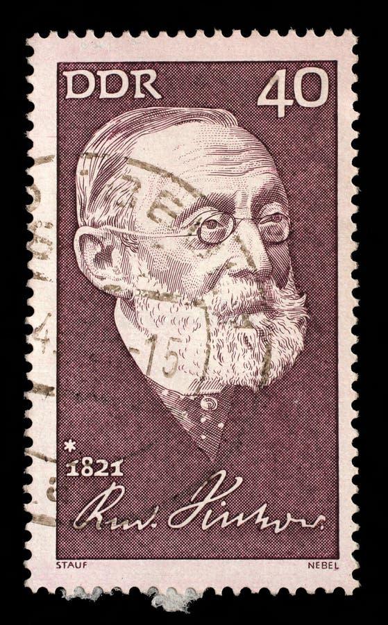 O selo impresso no GDR mostra o 150th aniversário do nascimento de Rudolf Virchow fotos de stock