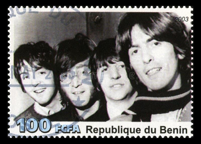 O selo postal de Beatles de Benin fotografia de stock