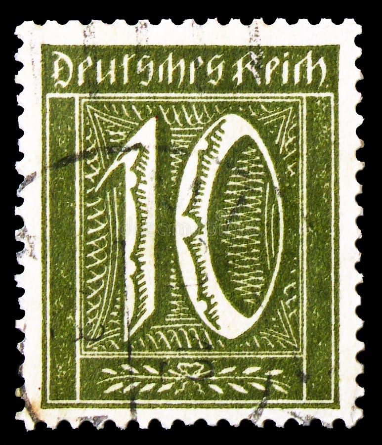 O selo postal impresso no Realm alemão mostra Numeral, Definitivos: Numerais, Trabalhadores, série de Posthorn, 10 reichspfennig  foto de stock royalty free