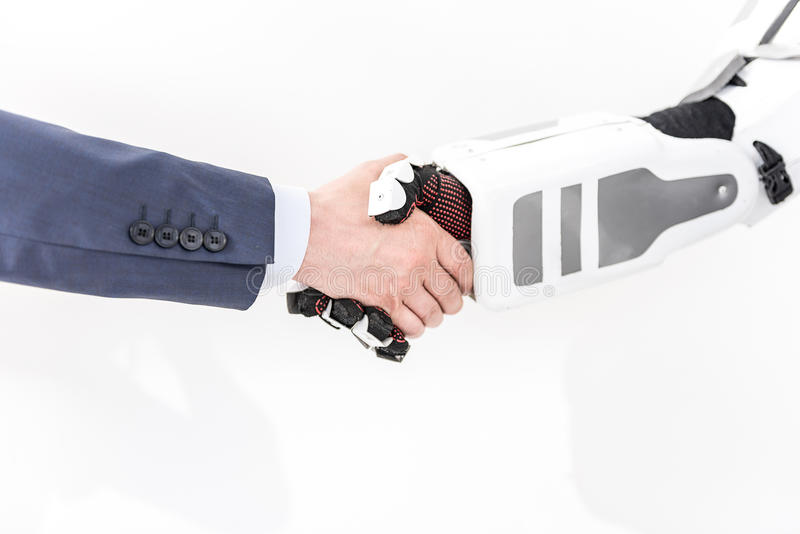 O ser humano gosta do robô que cumprimenta seu protótipo fotos de stock royalty free