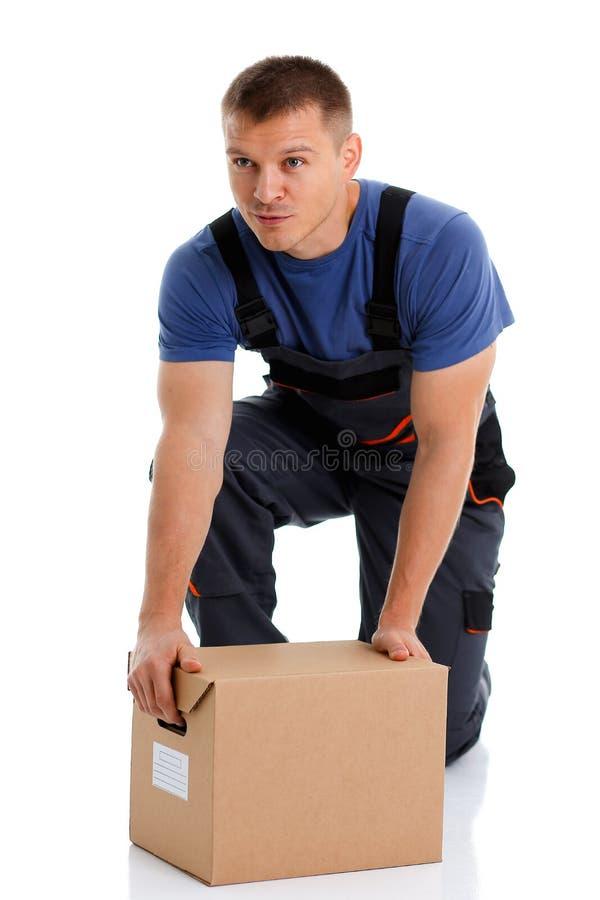 O serviço de entrega do correio do especialista leva caixas imagens de stock royalty free
