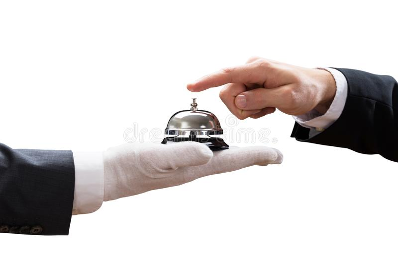 O serviço de soada Bell da mão do ` s da pessoa guardou pelo garçom imagem de stock