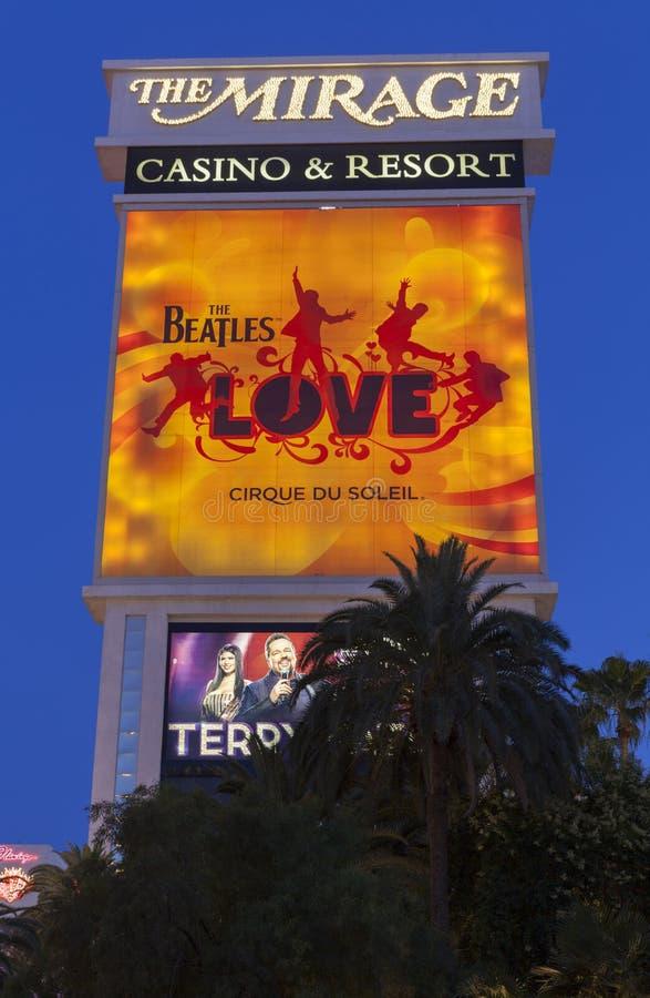 O sinal do hotel da miragem com o amor em Las Vegas, nanovolt de Beatles sobre imagem de stock