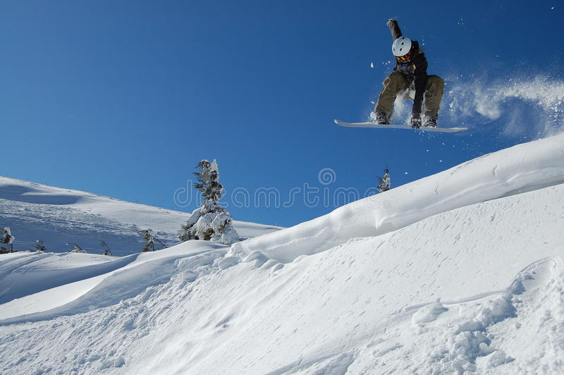 Salto da snowboarding imagem de stock royalty free
