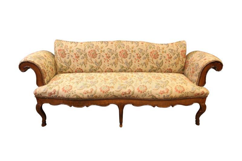 O sofá luxuoso antigo, com fantasia cinzelou o quadro de madeira e a decoração fotos de stock royalty free