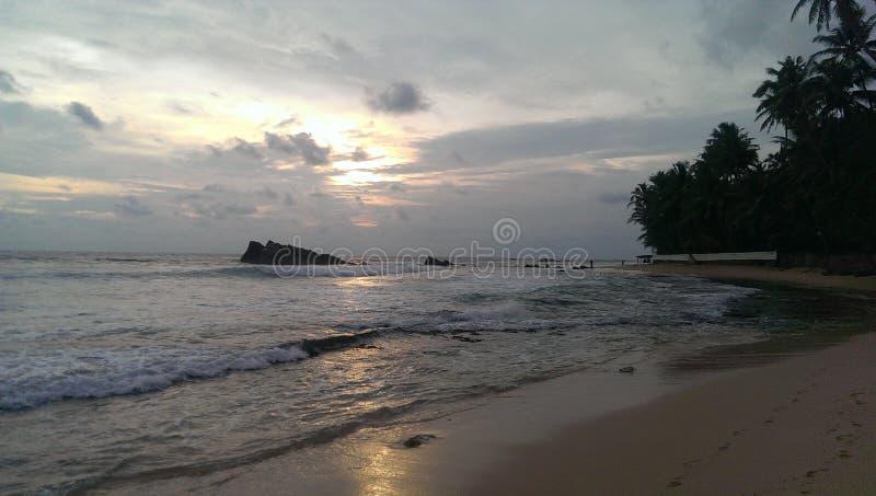O sol estava na praia foto de stock