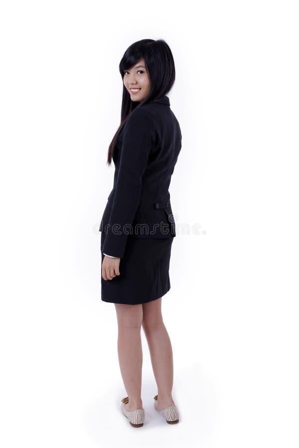 O sorriso asiático da mulher de negócio, gerencie para trás a cara para a câmera fotografia de stock