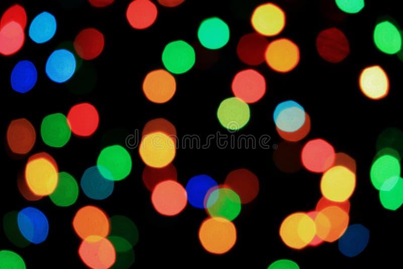 o sumário da Multi-cor borrou a iluminação iluminada no fundo preto foto de stock