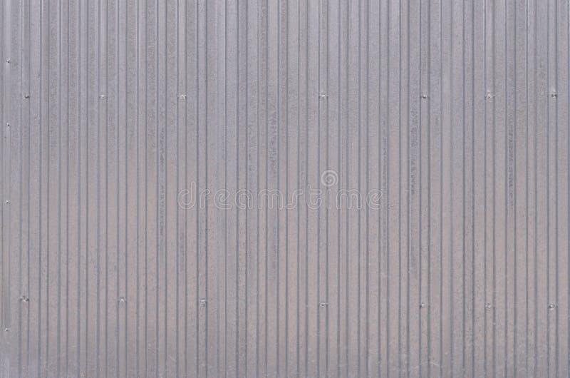 O tapume, metal almofada o close up da textura no dia fora foto de stock royalty free