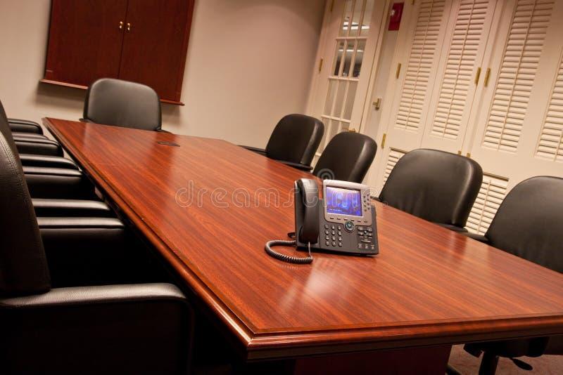 O telefone do negócio na tabela de conferência dobrou imagem de stock royalty free