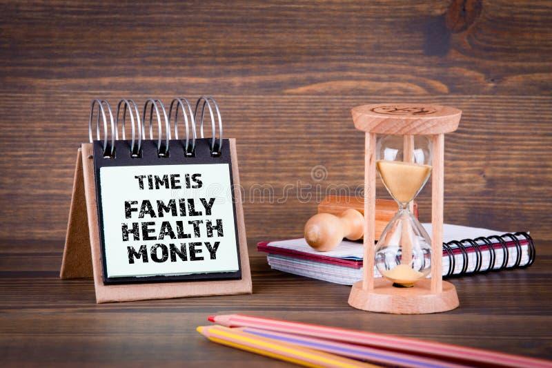 O tempo é família, saúde, dinheiro fotografia de stock