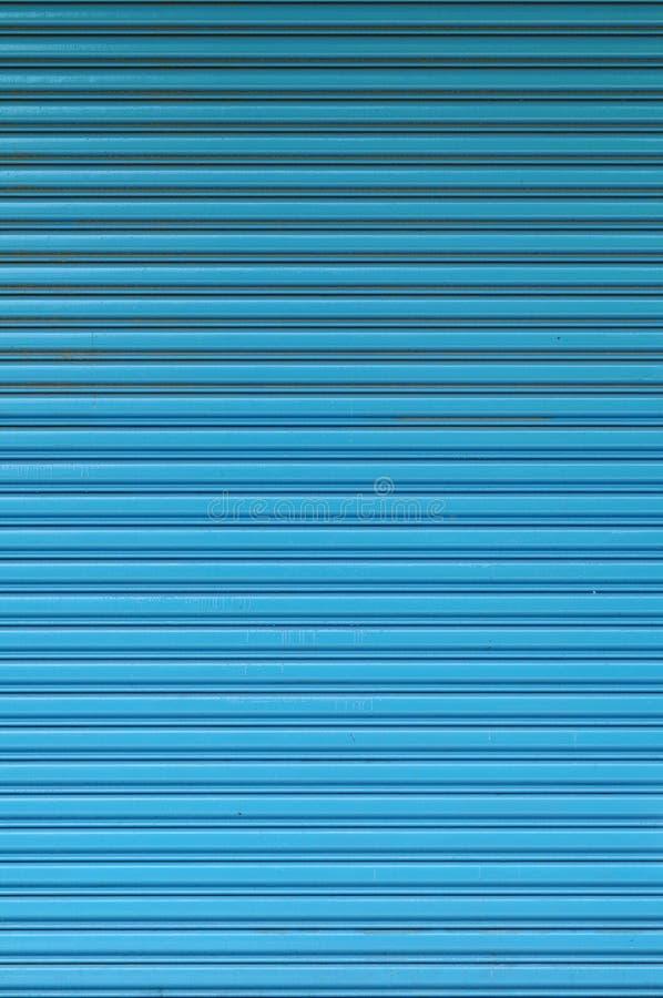 O teste padrão de azul rola acima a porta foto de stock royalty free