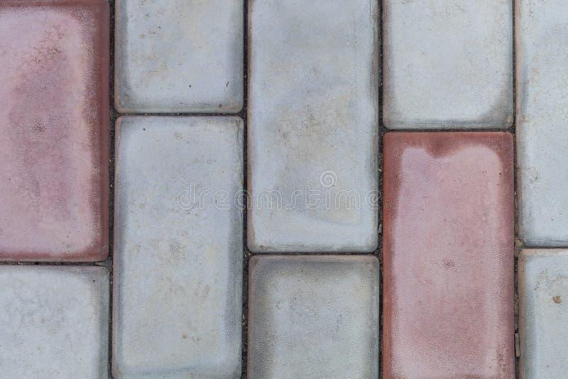 O teste padrão do bloco do tijolo na passagem, bloco do triângulo é diferença imagem de stock