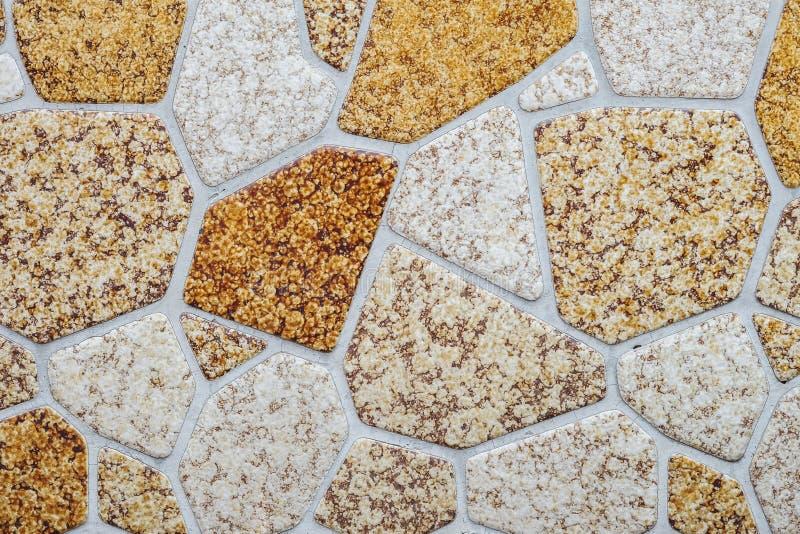 O teste padr?o de superf?cie do tijolo do close up na parede de tijolo de pedra textured o fundo imagens de stock