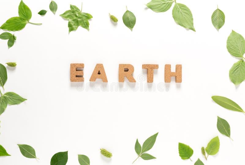 O texto da terra com verde sae da vista superior imagens de stock royalty free