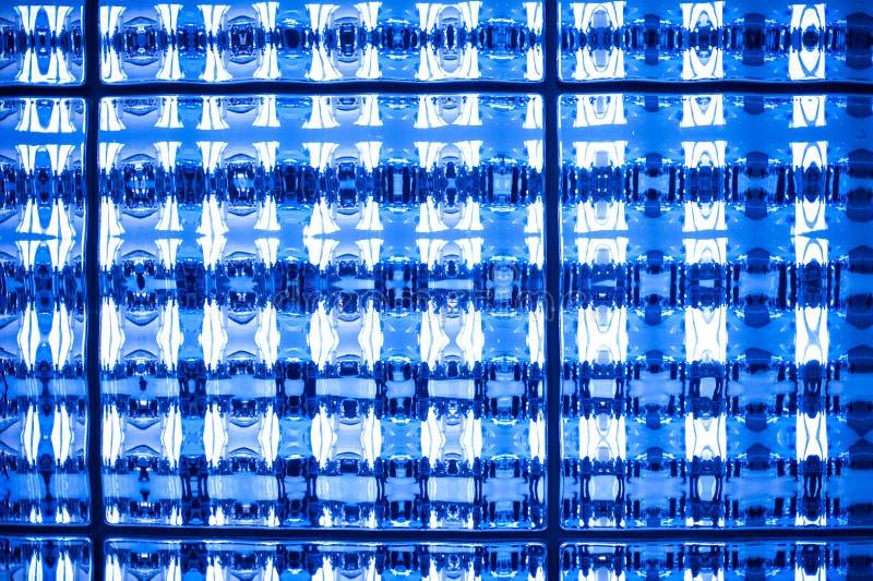 O tom azul abstrato manchou o fundo do papel de parede da textura do pixel do mosaico imagem de stock