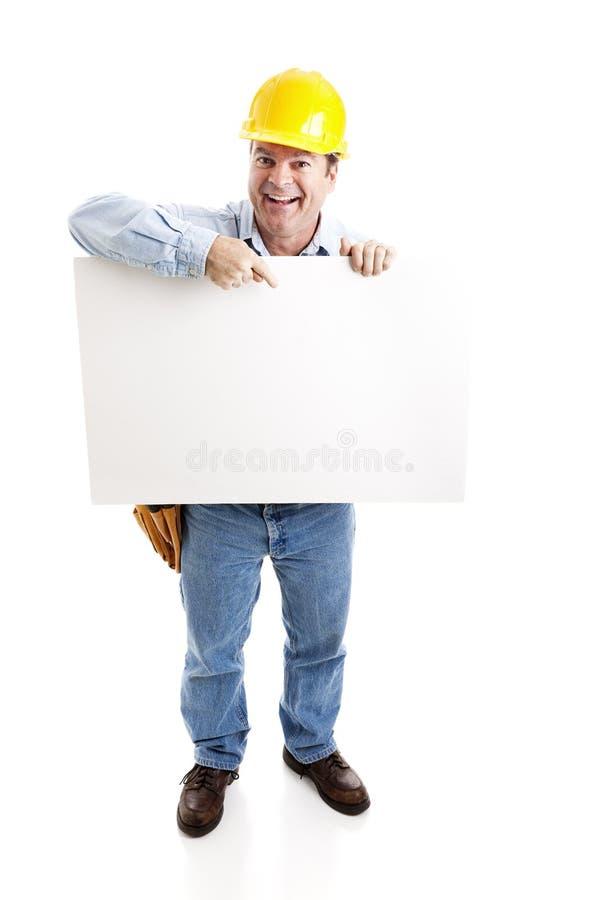 O trabalhador carreg o sinal em branco fotografia de stock