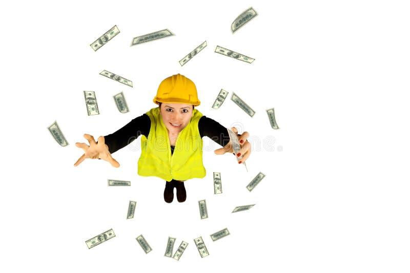 O trabalhador do colarinho azul empreende o dólar de voo do dinheiro no fundo branco fotografia de stock