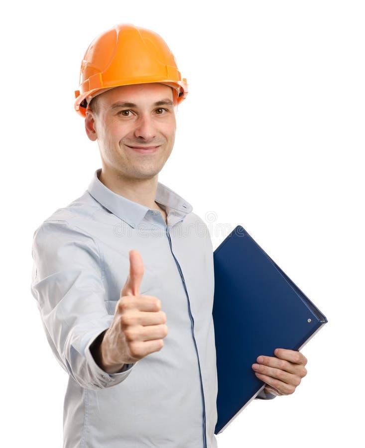 O trabalhador manual positivo mostra os polegares acima imagem de stock