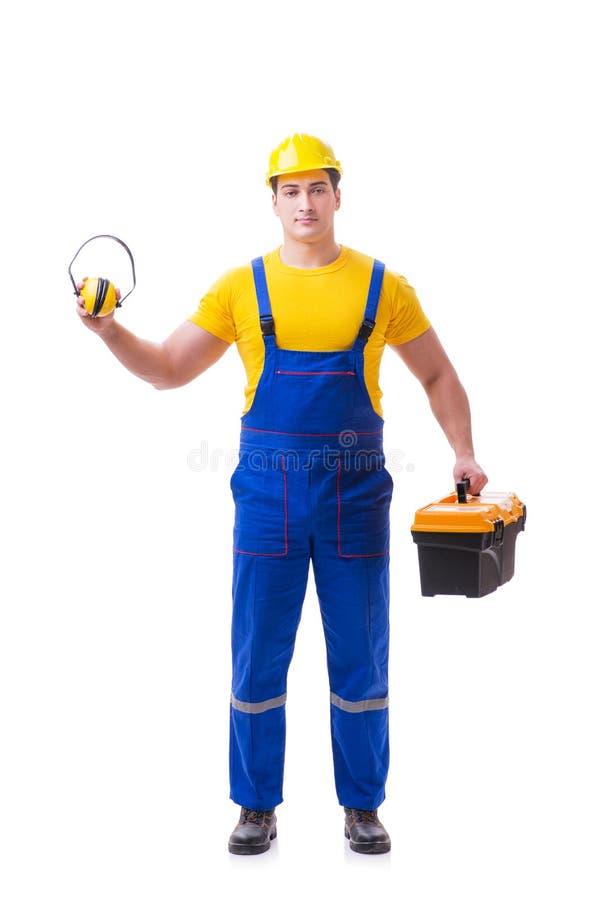 O trabalhador novo nas combinações isoladas no branco fotos de stock