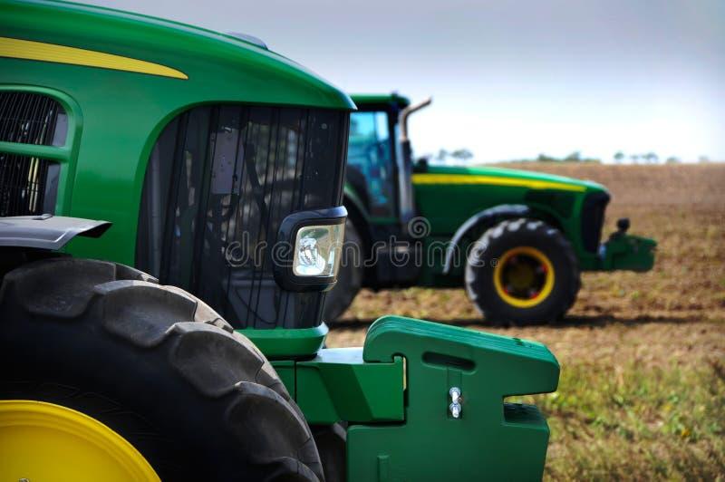 O trator - equipamento de exploração agrícola moderno imagens de stock royalty free