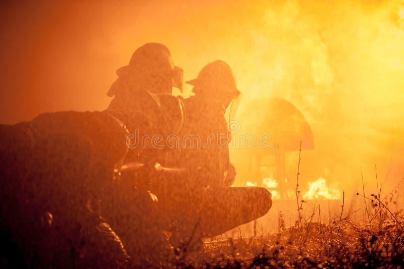 O treinamento do sapador-bombeiro imagens de stock royalty free