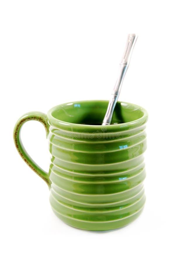 O verde curvou a caneca de café imagens de stock royalty free