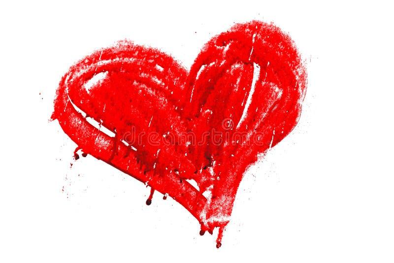 O vermelho coloriu o coração pintado manualmente com gotejamentos e imperfeições secas da pintura imagem de stock