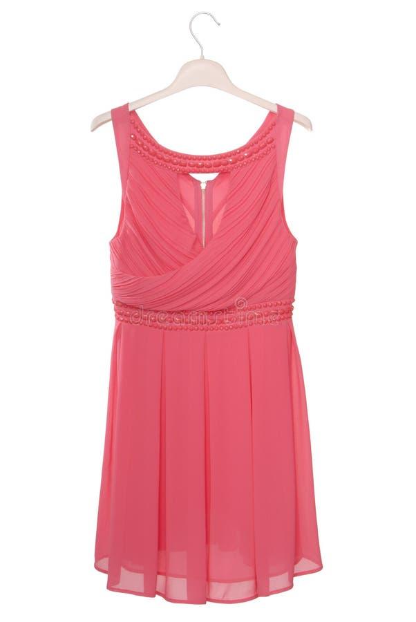 O vestido chiffon cor-de-rosa está no branco imagem de stock royalty free