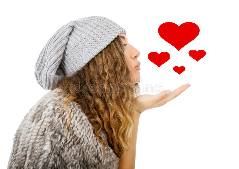 O vestido do inverno para um sopro beija a menina fotografia de stock