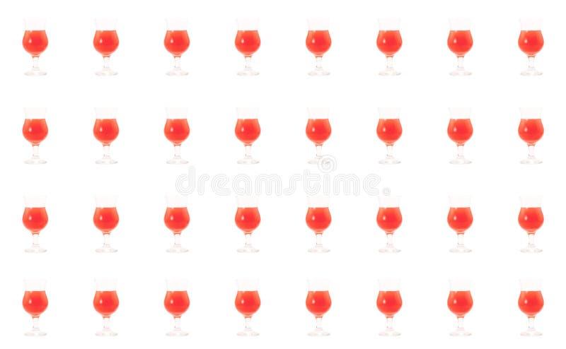 O vidro da mistura do nascer do sol do cocktail do suco de laranja brilhante transforma a bebida brilhante vermelha do tequila do fotos de stock royalty free