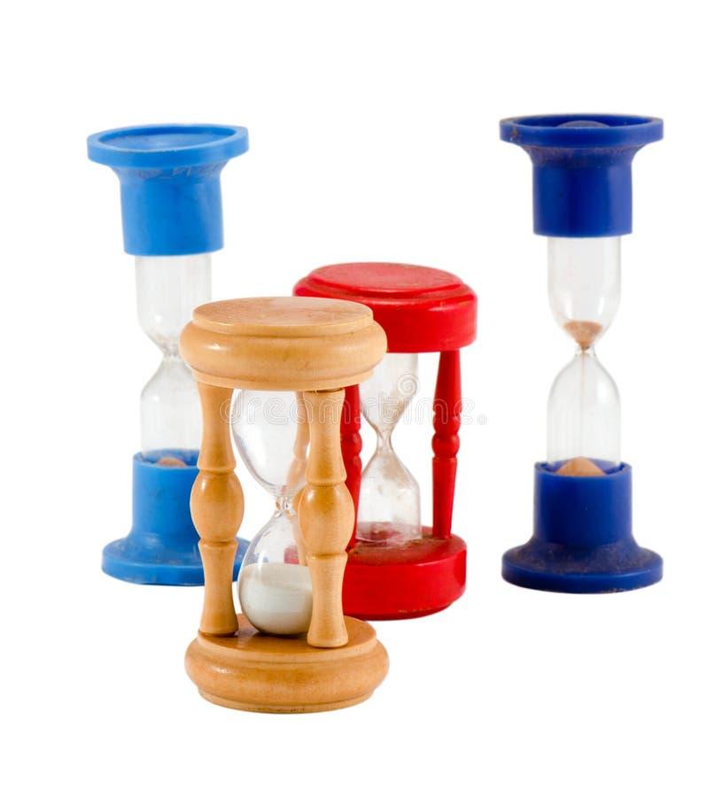 O vidro diferente da areia cronometra temporizadores isolou o branco fotografia de stock royalty free