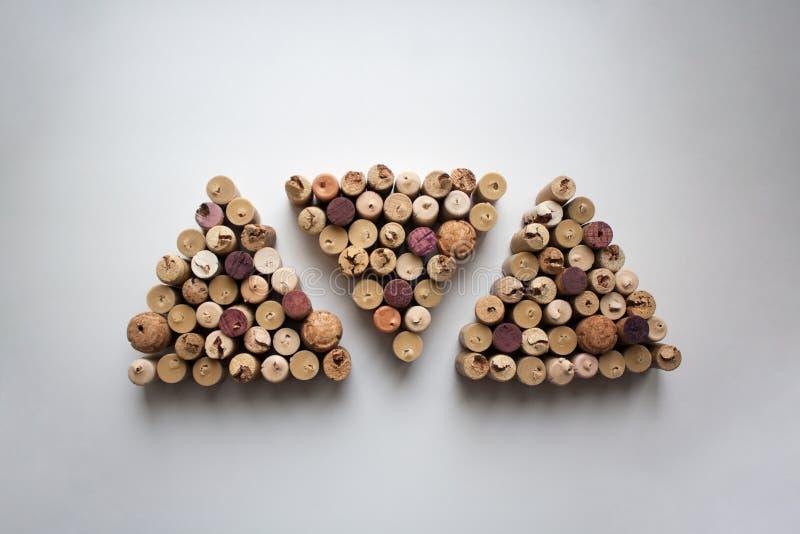 O vinho arrolha o teste padrão dado forma triângulo foto de stock royalty free