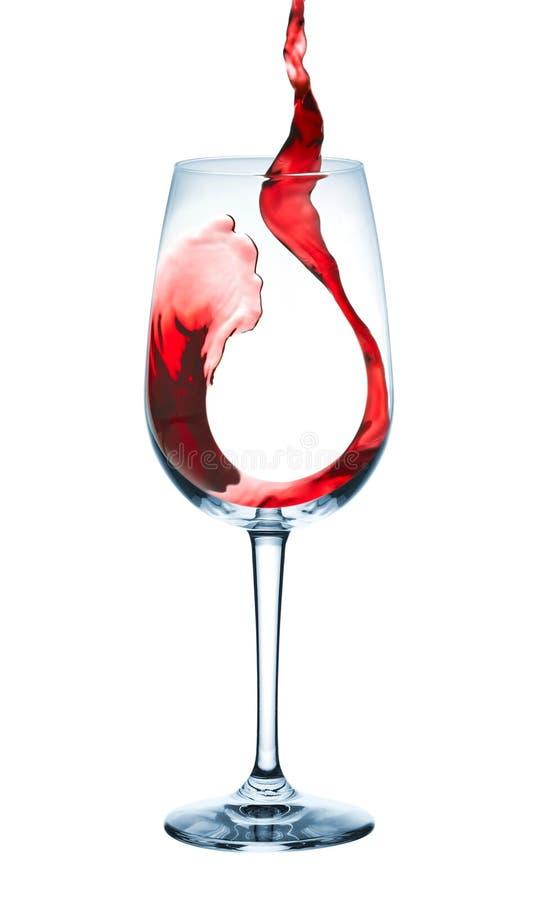O vinho derrama dentro o cálice imagens de stock