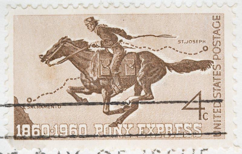 O vintage 1960 cancelou expresso de pônei do selo dos E.U. imagens de stock royalty free