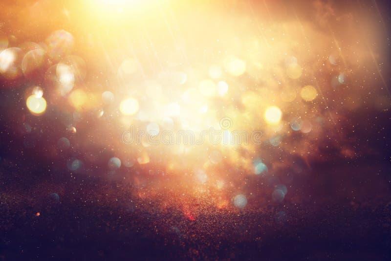 O vintage do brilho ilumina o fundo preto, azul, roxo e ouro de-focalizado ilustração stock