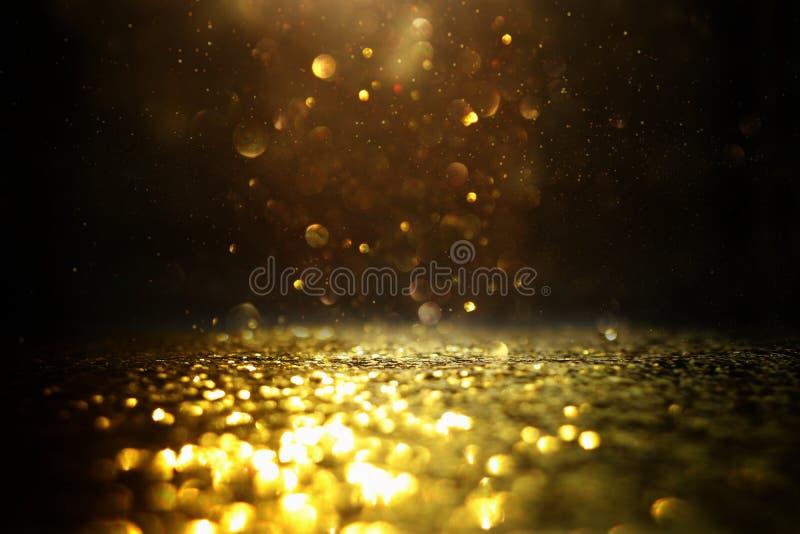 O vintage do brilho ilumina o fundo Preto e ouro de-focalizado ilustração stock