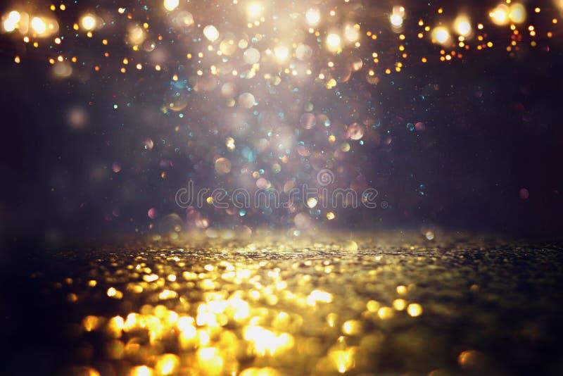 O vintage do brilho ilumina o fundo Preto e ouro de-focalizado ilustração do vetor