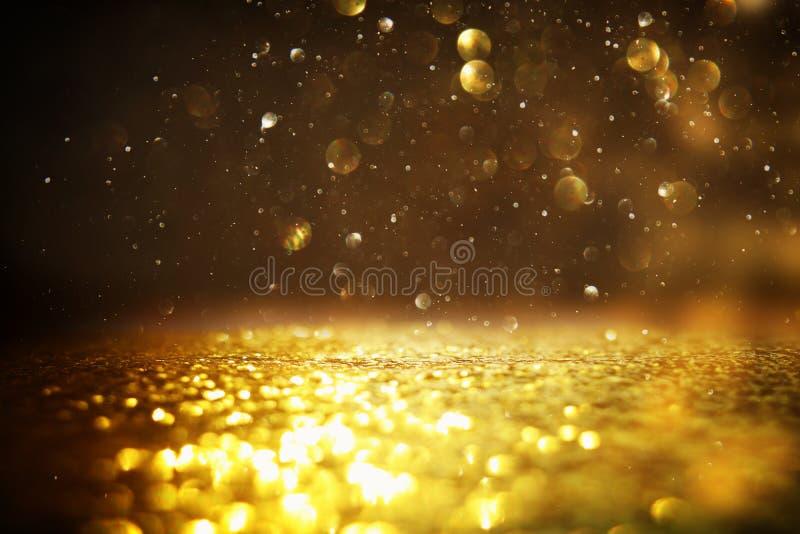O vintage do brilho ilumina o fundo Preto e ouro de-focalizado ilustração royalty free