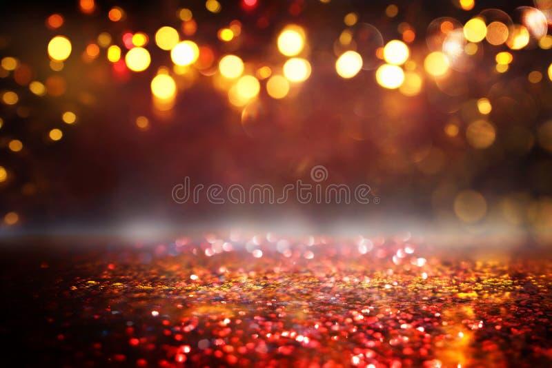 O vintage do brilho ilumina o fundo preto, ouro e vermelho de-focalizado ilustração do vetor