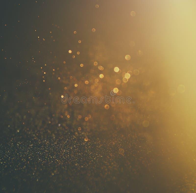 O vintage do brilho ilumina o fundo Ouro e preto defocused fotografia de stock