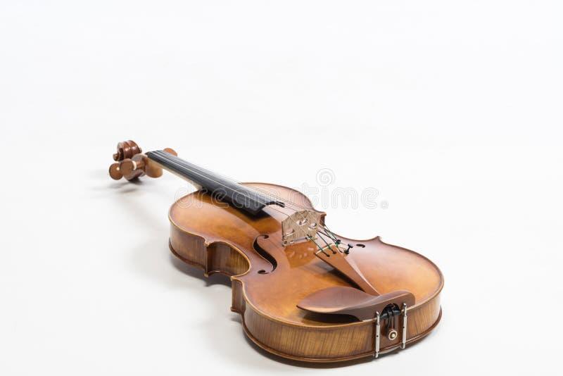O violino velho, isolado no fundo branco Viola, instrumento para a música imagens de stock royalty free