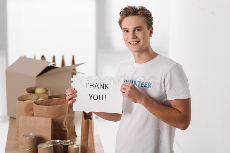 O voluntário com agradece-lhe afixar imagens de stock royalty free