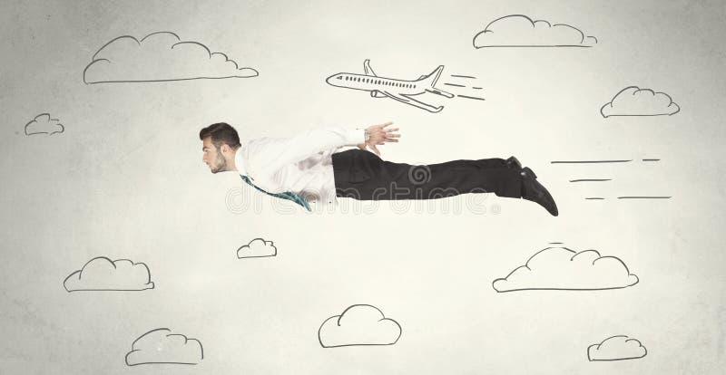 O voo alegre da pessoa do negócio entre o céu tirado mão nubla-se foto de stock