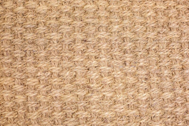 O weave grosseiro do fio, a textura de tapete trançado fotografia de stock royalty free