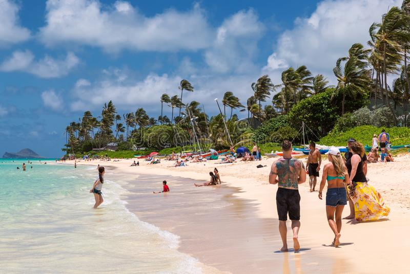 People resting on beautiful Lanikai beach on Oahu island royalty free stock image